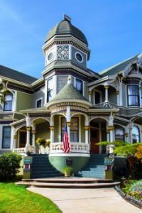 Green and white double-winged Victorian mansion in Alameda, California. - cdrin