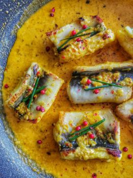 Went fishing this morning and ... made this turmeric and lemongrass eel with spicy coconut saffron cream sauce