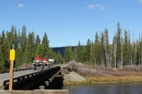 4 wheelers going across the Henrys Fork of the Snake River on the old RailRoad tressel in Island Park, Idaho.