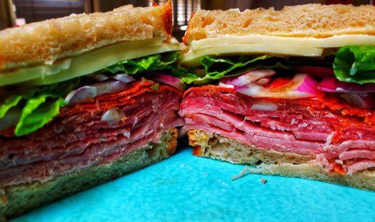 Black Forest ham, Italian salami, prosciutto, pepperoni, purple onion, romaine, balsamic oil, oregano, provolone cheese, Duke's mayo. On sourdough fresh from the oven