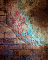 Decay - Exposed Bricks and Peeling Wallpaper