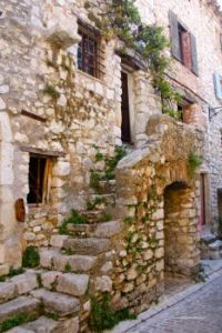 Stone house in medieval street of Tourrettes-sur-Loup, hilltop village in Provence, France