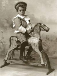 Vintage Portrait Of Toy Rocking Horse And Rider
