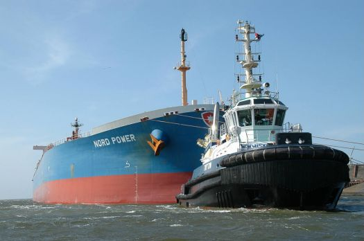 """Nord Power"" towed by tug ""Triton"" in Amsterdam harbour."