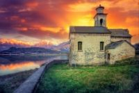 Old Church Along the Lake by The Alps at Sunset...