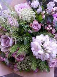 Happiness is....Bunch of Fresh Flowers in shades of Purple.