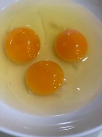 Three Eggs in White Bowl