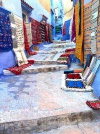 Carpet shops in alleyway in Chefchaouen, Morocco