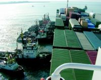 Multraship tugs are seen pushing the damaged containership Fowairet - See more at- http-::www.maritimejournal.com:news101:tugs,-