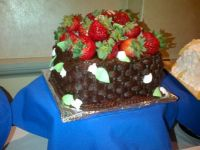 basket cake filled with strawberries