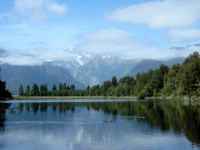 NZ Lake Matheson with Mt Cook behind the clouds