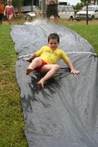 Grandson on water slide