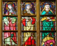 91321454-stained-glass-window-in-the-cathedral-of-saint-bavo-in-ghent-flanders-belgium-depicting-catholic-sai