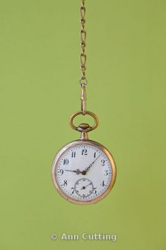 Pocket watch with green background