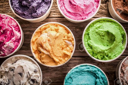 27128938-array-of-different-flavored-colorful-ice-cream-in-plastic-tubs-displayed-on-an-old-wooden-table-at-a