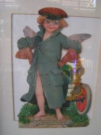 Antique die cut boy chauffeur