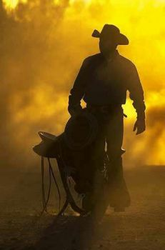 Cowboy and dusty sunlight