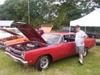 Me at car show with my son.