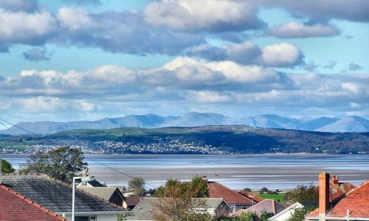 The Coniston fells present a backdrop to Hampsfell and Grange-Over-Sands, Cumbria.  Photo by Arnold Price