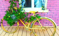 bike with flowers near red brick building