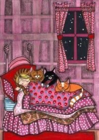 Girl asleep with cats