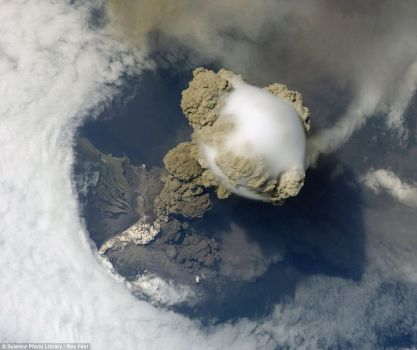 Pileus cloud above an erupting volcano