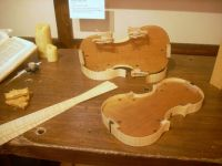 Creating a violin.