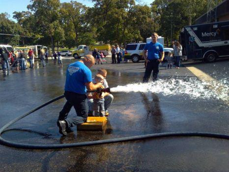 Blayne  using the fire hose