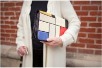 Judith Leiber holding her Mondrian handbag-a tribute