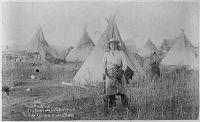 Young-Man-Afraid-of-His-Horses (Tashun-Kakokipa), an Oglala Sioux; standing in front of his lodge, Pine Ridge, South Dakota