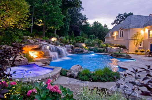Beautiful Swimming Pool With Waterfall And Colorful Flower For Pretty Look