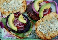 Portabello mushroom burger with homemade pesto mayonnaise, avocado and grilled red onions