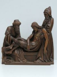Woodcarving of Christ placed in the tomb