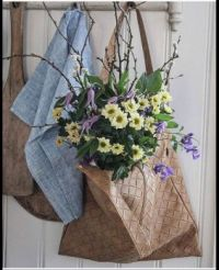 Flowers in a leather bag