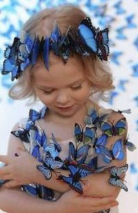 A girl with blue butterflies