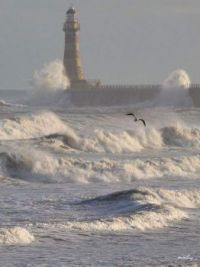Lighthouse in brewing storm