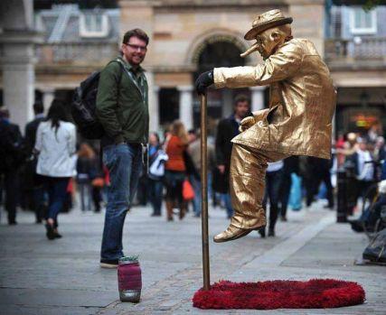 Street artist performs at Convent Garden, London