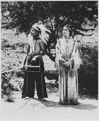 Cherokee boy and girl in costume on reservation, North Carolina
