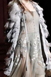WEDDING THEMES:  feather coat
