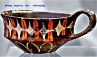 Cup decorated with polychrome Kamares Ware motif.