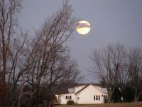 a fall moon sheds its light over Mis' Annie's farm