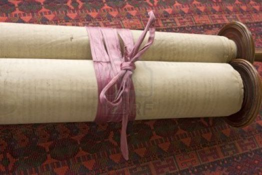 Vintage Torah, tied with faded purple ribbon to keep it from unrolling.