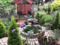 Bird bath in circle garden at Dragonfly Crossing
