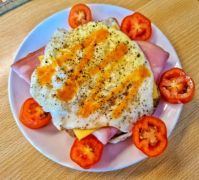 Breakfast - Bologna salami, cheddar cheese, over medium fried egg, garlic sauce and cherry tomatoes