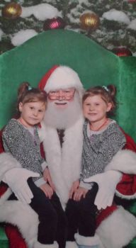 My granddaughters 1st time on Santa's lap.