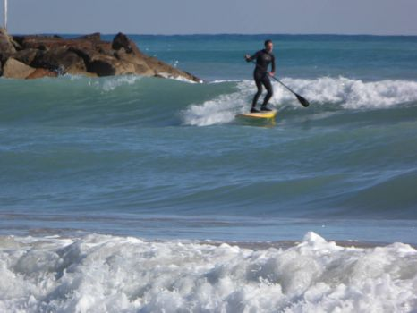 Spain. The surf-boarder now 'caught' a good wave!