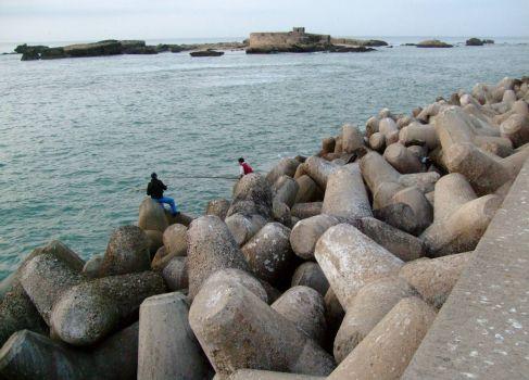 Sea defences in Essouira with fishermen