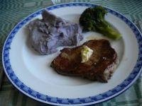 Pork chop, broccoli and blue mashed potatoes