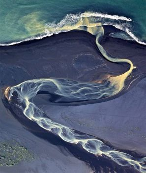 Aerial photograph of a river flowing through a bed of volcanic ash in Iceland - photog unknown