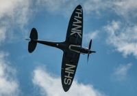 SPITFIRE FLYING OVER NORFOLK HOSPITALS ENGLAND